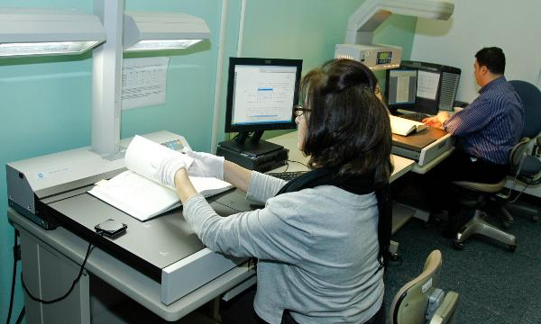Staff digitizing documents
