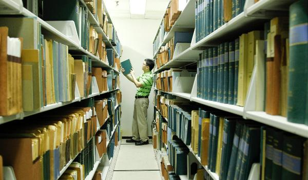Librarian searching in the Library stacks